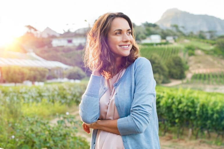 Satisfied woman feeling peaceful and happy